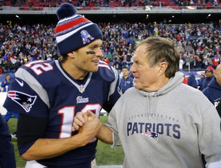 Dec 14, 2014; Foxborough, MA, USA; New England Patriots quarterback Tom Brady (12) celebrates with head coach Bill Belichick (R) after clinching the AFC East title with a 41-13 win over the Miami Dolphins at Gillette Stadium. Mandatory Credit: Winslow Townson-USA TODAY Sports ORG XMIT: USATSI-180434 ORIG FILE ID:  20141214_ads_bt1_125.JPG